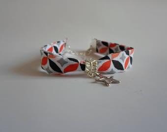 black/orange patterned fabric bracelet