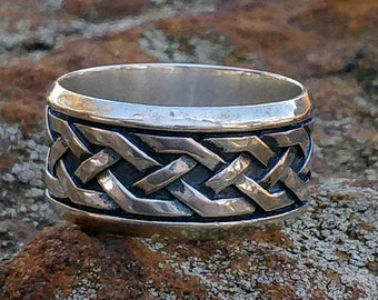 wide silver band with celtic classic pattern