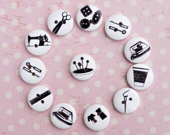 12 wooden buttons with different craft designs. Ø 15 mm