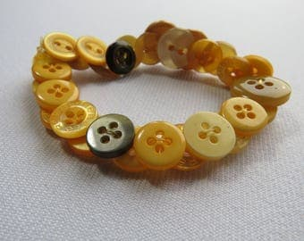 Yellow upcycled button bracelet