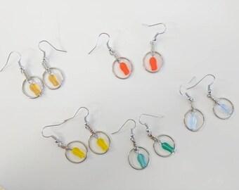 Fish in hoops earrings