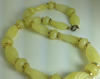 1940s Lucite Pale Lemon Beaded Necklace.  Translucent Moulded Beads. Gold Tone Spacers. Old Clasp.