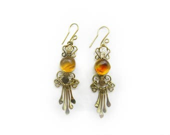amber earrings / medium light yellow stone with golden brown texture / round shaped / wrapping wire / mexican amber