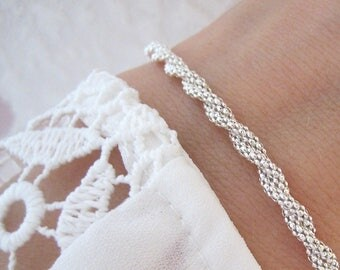 Twisted sterling silver 925/1000 silver braided bracelet