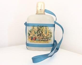 Old bottle souvenir of holy water Lourdes (empty). Vintage