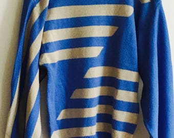 Vintage blue sweater with abstract stripes