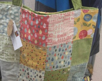 Quilted Tote Bag // Greys, reds, yellows, Fabric Patterns of bicycles, raindrops, houses. Diaper Bag, Book Bag, Carry-on Bag, Shopping Bag