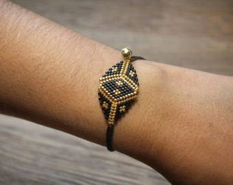 Ethnic bracelet black and gold
