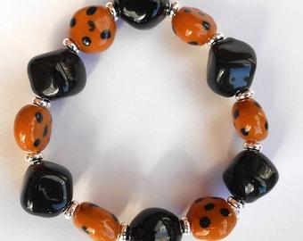 Black Kazuri  ceramic bracelet, fair trade beads, black and caramel