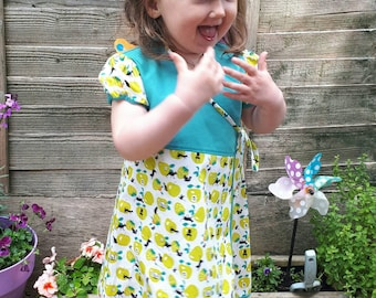 Wrap around girls dress 2-3 years. Lime & teal with animal silhouette's.