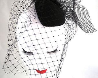 oval black felt with veil fascinator.