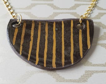 Semicircular pendant with gold plated chain