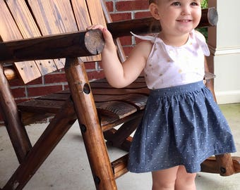 Summer toddler dress with pink, white and gold flamingos, open back, and chambray polka dot skirt