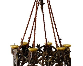carved wood neogothical chandelier with candles