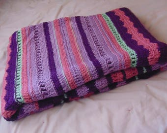 Handmade purple stripe afghan.