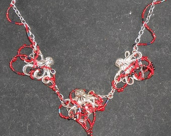 Necklace - Octopus with Treasure in red.