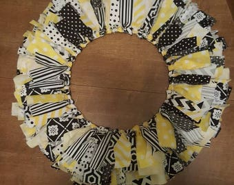 Yellow, black and white material ragged wreath