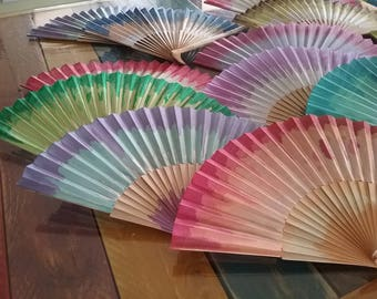 Hand held cotton and wood fans