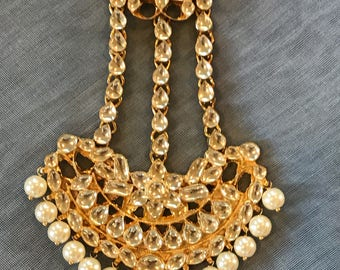 Gold finish jhumar with shell pearls