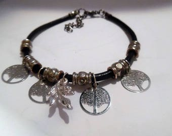 leather strap and metal charm