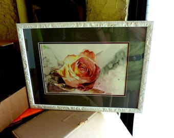 a framed rose watercolor