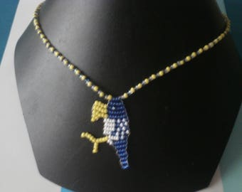 """Crow"" necklace with seed beads."