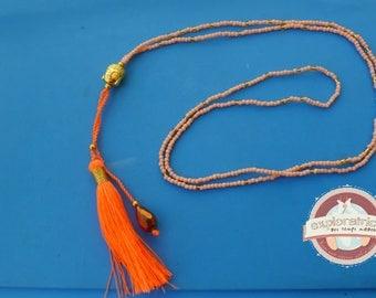 ethnic necklace pink glass bright orange tassel and Buddha gold