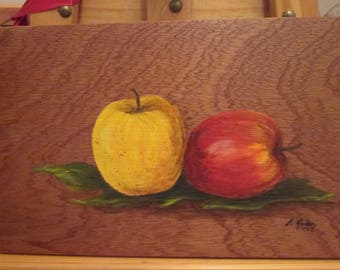 Still life with apples painted on wood.