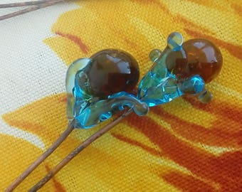 Duets with flowers in Blue Lagoon and amber heart - Lampwork Glass