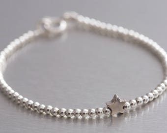 Silver beaded bracelet with star