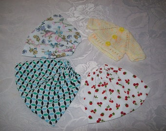 clothes for dolls 32 33 cm, with babies (3 skirts in printed cotton and a vest or sweater)