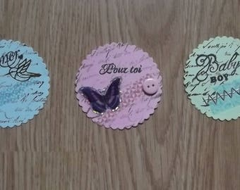 3 round tags are scalloped for your scrapbooking creations.