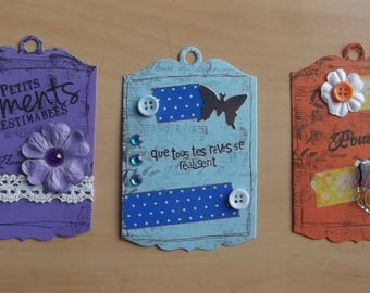 3 tags, 1 Purple 1 blue and 1 orange for your scrapbooking creations.
