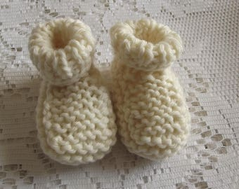 Off-white baby booties, baby.