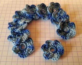 Applique crochet cotton flowers in blue shades