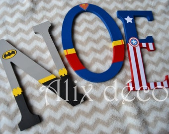Child's name in wooden letters painted and decorated to hang theme superhero (made to order)