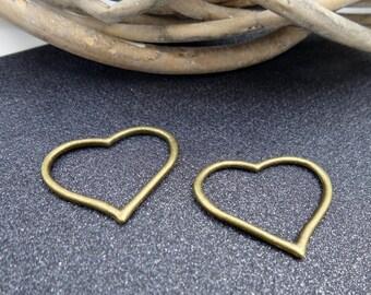2 bronze metal heart connectors