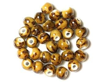 10pc - yellow balls 10mm - 4558550012180 Brown ceramic beads