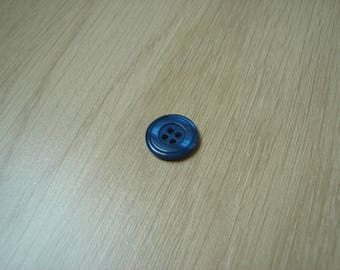 Blue round button on the back
