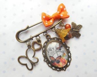 "Broche cabochon verre 25X18 mm ""bingo love"" bronze, orange, marron, perles, papillons, breloques, noeud en tissu"
