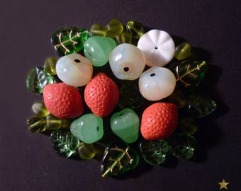 30 mixed green, orange, white Czech glass beads.
