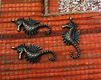 bronze 4 seahorses, finely shaped charms pendants