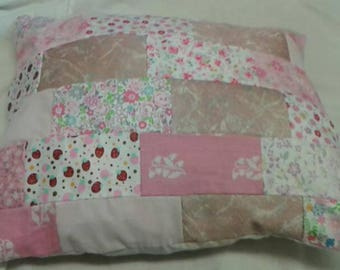 Pink and white patchwork cushion