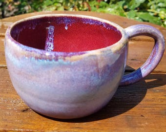 Purple handmade, wheel thrown pottery mug.