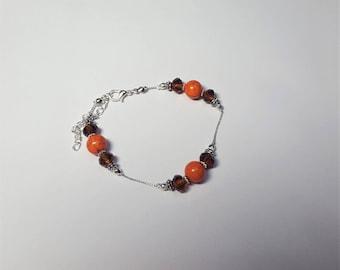Howlite and orange and brown crystal bracelet