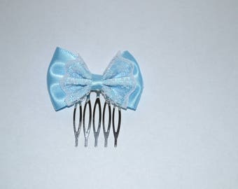 A blue bow and lace hair comb