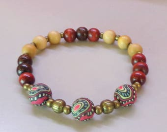 Bracelet wood and rubber beads psychedelic pattern