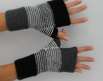 Black, gray hand knitted mittens grey and ivory white
