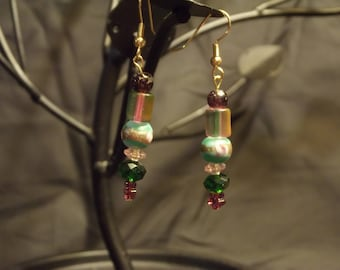 Green and gold dangling earrings
