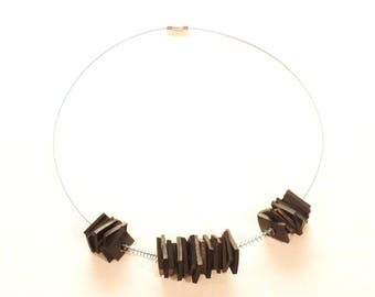 Necklace inner tube and recycled springs